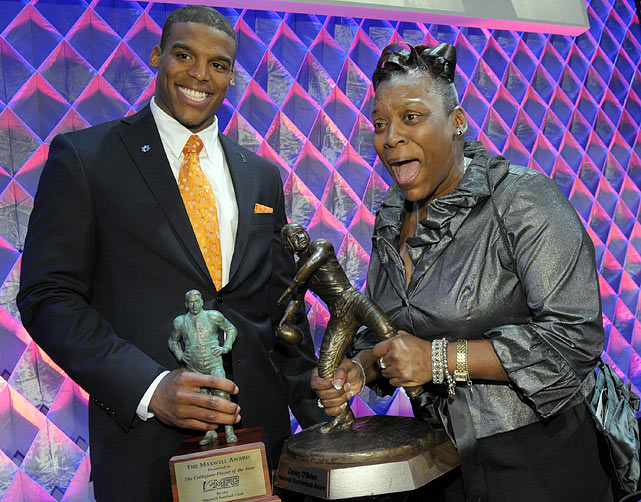 Cam's mom, Jackie Newton, reacts with surprise to the weight of the Davey O'Brien Award.
