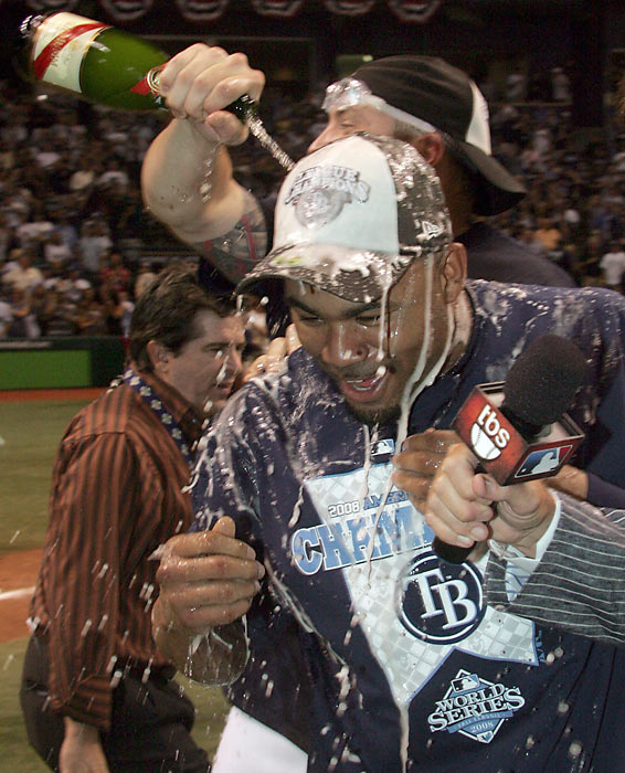 Crawford is doused with champagne after the Rays knocked out the Red Sox in seven games to earn a spot in the World Series.