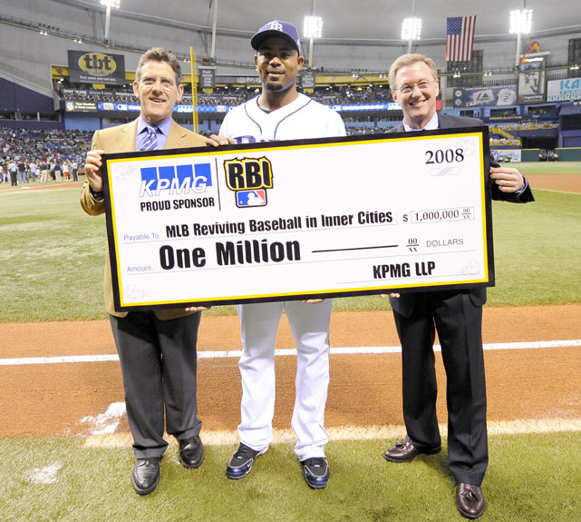 MLB Executive VP of Business Tim Brosnan, Crawford and KPMG Chairman Tim Flynn present a check to RBI before Game 2 of the World Series.