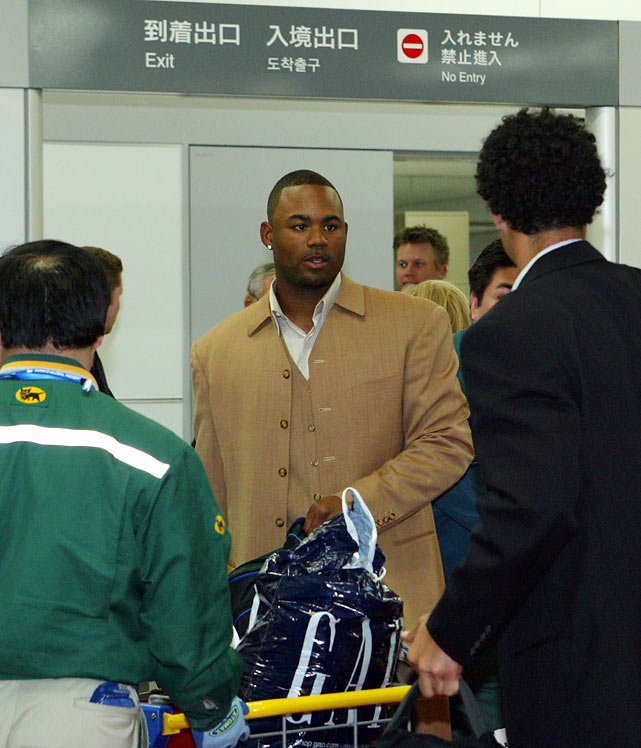 Crawford arrives at Tokyo International Airport for Tampa Bay's two-game season opener against the Yankees.
