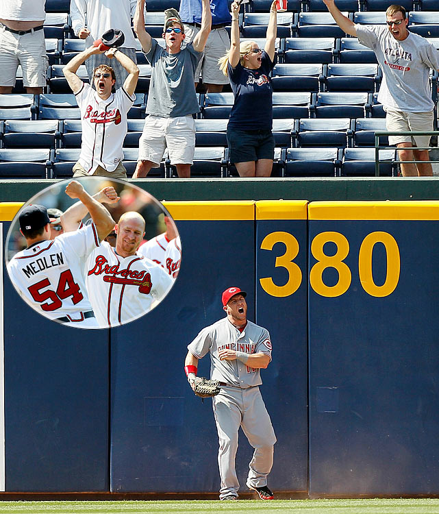 The Braves pulled off the biggest ninth-inning comeback of the year, scoring seven times to beat the Reds in Atlanta. Brooks Conrad capped the amazing rally with a walk-off grand slam. Reds left fielder Laynce Nix appeared to have caught the ball with an over-the-wall catch, and even Conrad thought it was an out before realizing the ball had deflected off Nix's glove and over the fence.