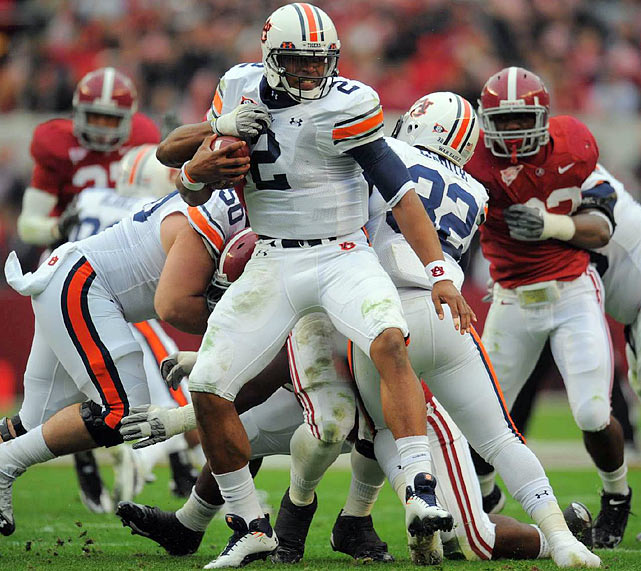 For weeks, Auburn detractors had circled the Nov. 26 Iron Bowl in Tuscaloosa as the day of reckoning for Cam Newton and the Tigers. When Alabama jumped out to a 24-0 first-half lead, the skeptics seemed vindicated. But then Newton came to life, throwing three touchdowns and rushing for another to lead No. 2 Auburn to a thrilling win over the defending national champions. The biggest comeback in Auburn history was also the signature performance of Newton's Heisman-winning season.