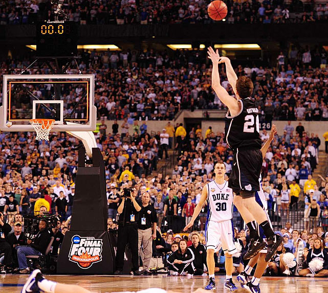 The Bulldogs made a captivating run to the national title game -- played in Lucas Oil Stadium in Indianapolis, just 5.6 miles from the Butler campus -- and came within inches of bringing home a championship for the ages. But Gordon Hayward's majestic, half-court heave rimmed out at the buzzer and the Blue Devils won their fourth national title. The scintillating David-vs.-Goliath showdown was a back-and-forth contest throughout, as neither team led by more than six points. This was only the 11th championship game decided by two points or fewer and the first since Michigan defeated Seton Hall 80-79 in 1989.