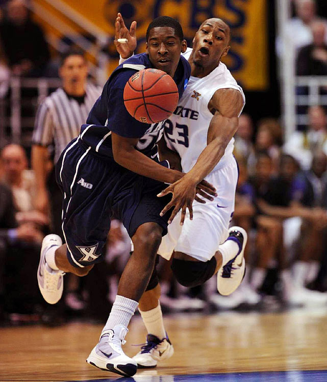 "Thirteen lead changes, 17 ties, two overtimes and oh, so many clutch shots. This instant classic, played at a breakneck pace, was a battle of two dynamic backcourts: Xavier's Jordan Crawford and Terrell ""Tu"" Holloway vs. Kansas State's Jacob Pullen and Denis Clemente. Holloway converted three free throws at the end of regulation to send the game to overtime and Crawford (career-high 32 points) ripped a 35-foot three to tie it late in the first OT, but the second-seeded Wildcats prevailed after Pullen (28 points) hit two threes in the second extra period."