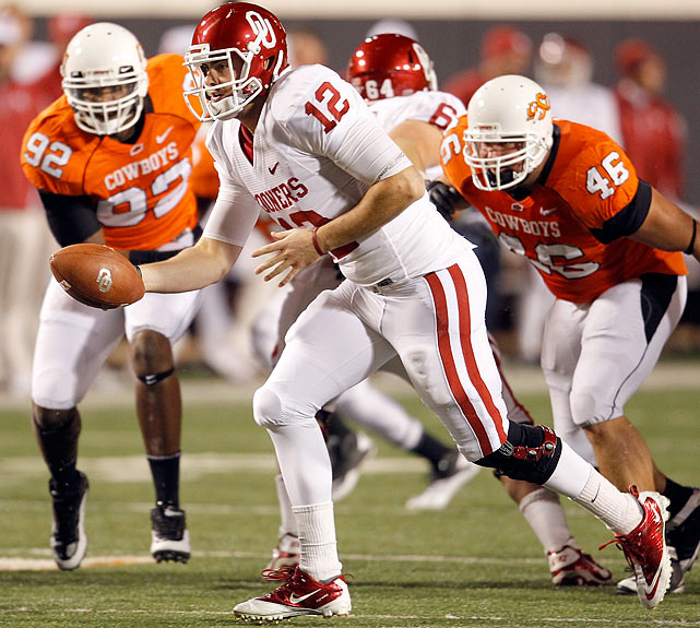 Rarely has the Bedlam game so lived up to its name. Thanks to two road losses on the season, No. 14 Oklahoma set off for Stillwater as a rare underdog against instate rival and 10th-ranked Oklahoma State. But a career passing day from Landry Jones (468 passing yards, four touchdowns) secured the Sooners a share of the Big 12 South title and a trip to the Big 12 Championship Game thanks to an edge in the BCS standings. The teams combined for 967 yards of total offense and 10 total touchdowns and exchanged two touchdowns apiece in the span of 92 seconds late in the fourth quarter.