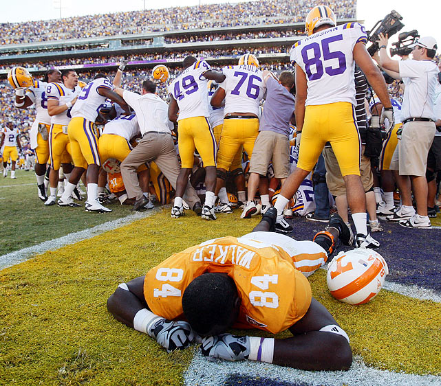 "Not for nothing do they call Les Miles the Mad Hatter. No. 12 LSU trailed by four and faced a third-and-goal at the Tennessee two-yard line. The Tigers had no timeouts. With the clock approaching zero, LSU began shuffling players. Baffled, Tennessee did too. LSU quarterback Jordan Jefferson called for the snap with three seconds remaining. It sailed right by him. Tennessee's sideline exploded as time expired. Then everything changed. Officials reviewed the play and found that Tennessee had 13 players on the field when LSU snapped the ball. The penalty gave LSU an untimed down from the half-yard line, and tailback Stevan Ridley scored the game-winner. ""It went from a cry, to a frown, to a smile, to a realization of how you really won the game,"" LSU linebacker Kelvin Sheppard said."