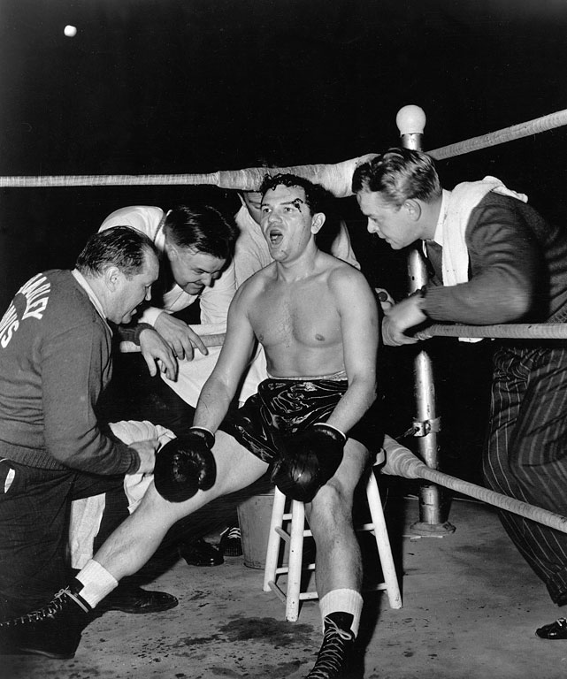 "Directed by Robert Rossen. Starring John Garfield, Anne Revere, William Conrad.   THE STORY  Charley Davis (Garfield) is the ghetto youth who boxes his way to the title before receiving the directive to take a dive from his cynical promoter. When he rebels and wins by knockout in the last round, he must answer to the mob.  THE LEGACY  Cinematographer James Wong Howe achieved the unique visual style of the fight scenes by shooting the action on roller skates with a hand-held camera. The film noir was nominated for four Oscars, winning for Film Editing. Its influence can be seen in nearly every boxing film that came after it, from  Champion  to  Raging Bull .  THE QUOTE  ""What are you gonna do, kill me? Everybody dies.""  --Charley Davis (Garfield)"
