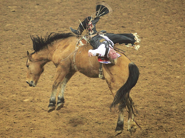 Wes Stevenson of Lubbock, Texas, rides Street Dance as he competes in the bareback riding event during the 10th go-round of the National Finals Rodeo in Las Vegas. Stevenson's efforts at the NFR moved him into ninth place in the world standings.