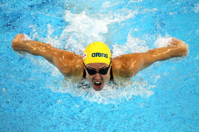Swedish swimmer Therese Alshammar competes in the women's 100-meter butterfly heats on day four of the 10th FINA world swimming championships at the Hamdan bin Mohammed bin Rashid Sports Complex on Dec. 18 in Dubai, United Arab Emirates.