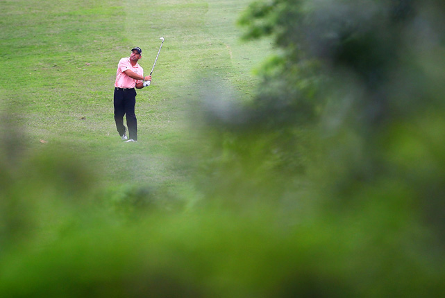 South African golfer Hennie Otto watches his shot during the second round of the South African open golf championship at the Durban Country Club on Dec. 18 in Durban, South Africa.