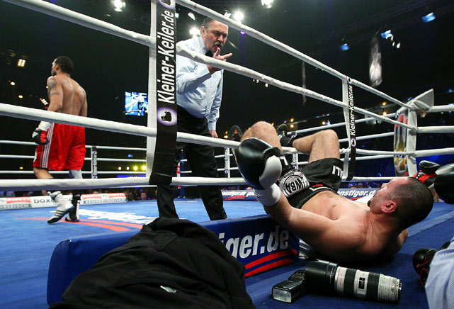Ali Ismailov of Azerbaijan falls out of the ring after Yoan Pablo Hernandez of Cuba knocked him out during their WBA cruiserweight eliminator fight at Max-Schmeling Hall on Dec. 18 in Berlin, Germany.