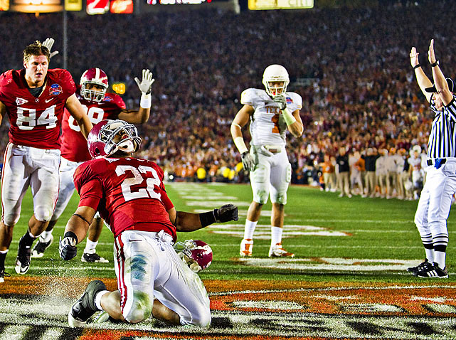 Alabama Crimson Tide running back and 2009 Heisman Trophy winner Mark Ingram celebrates after scoring a touchdown against Texas during the fourth quarter of Alabama's 37-21 victory in the BCS National Championship Game at the  Rose Bowl in Pasadena, Calif.