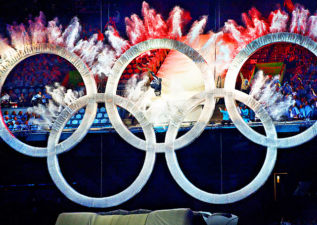 Canadian snowboarder Johnny Lyall jumps through the Olympic rings during the Vancouver Winter Olympics opening ceremony.  It was the first Olympics opening ceremony to be held indoors.