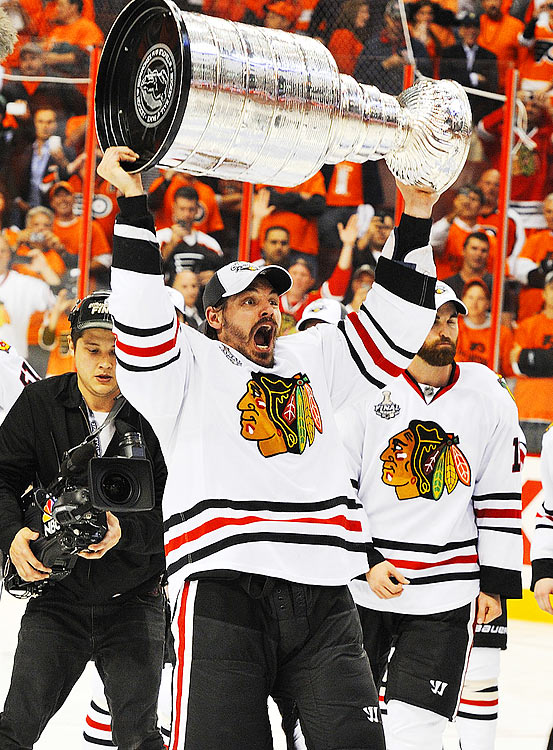 Chicago Blackhawks defenseman Brent Sopel hoists the Stanley Cup over his head after the Blackhawks defeated the Flyers 4-3 in overtime of Game 6 at the Wachovia Center in Philadelphia.