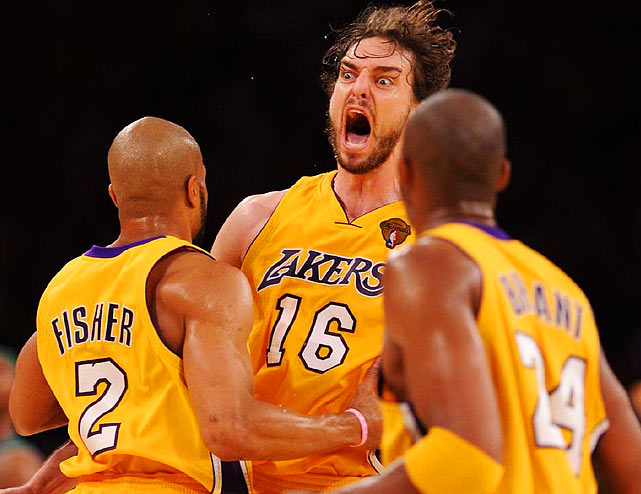 Pau Gasol (16) rejoices with Derek Fisher (2) and Kobe Bryant after the Lakers defeated the Celtics 83-79 to win the NBA Finals at the Staples Center in Los Angeles.