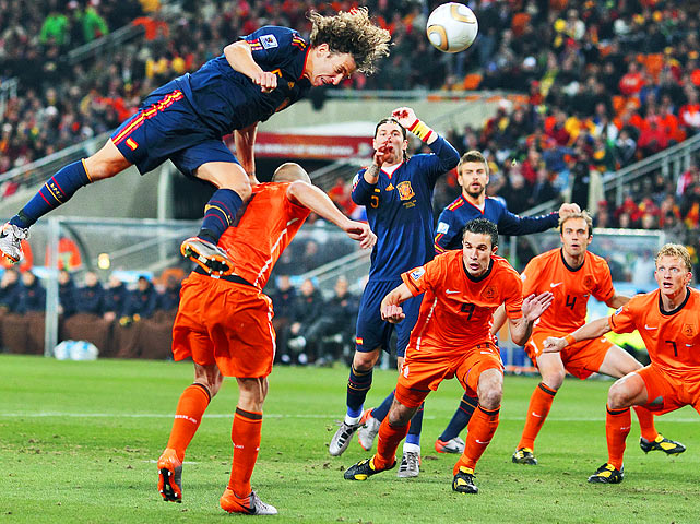 Spanish defender Carles Puyol (left) jumps for a header over Dutch defender John Heitinga during Spain's 1-0 victory in the World Cup final at Soccer City Stadium in Soweto, South Africa.