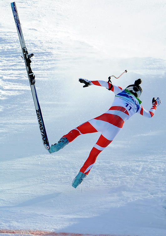 Swiss skier Dominique Gisin crashes during the women's downhill in the Vancouver Olympics in Whistler, Canada.  She would leave the course under her own power.