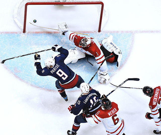 Zach Parise of the U.S. scores on Roberto Luongo of Canada to tie the  gold medal game at 2-2.  The U.S. would later fall to Canada in overtime.