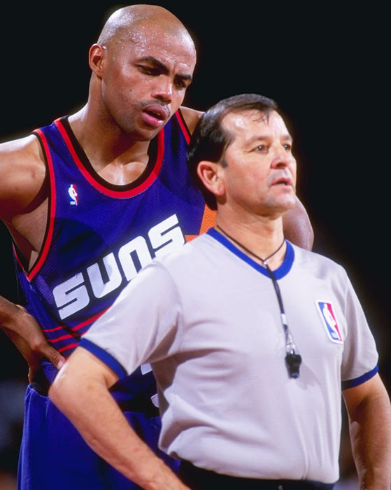 Charles Barkley has some fun with an official during a 1993 game against the Nuggets.