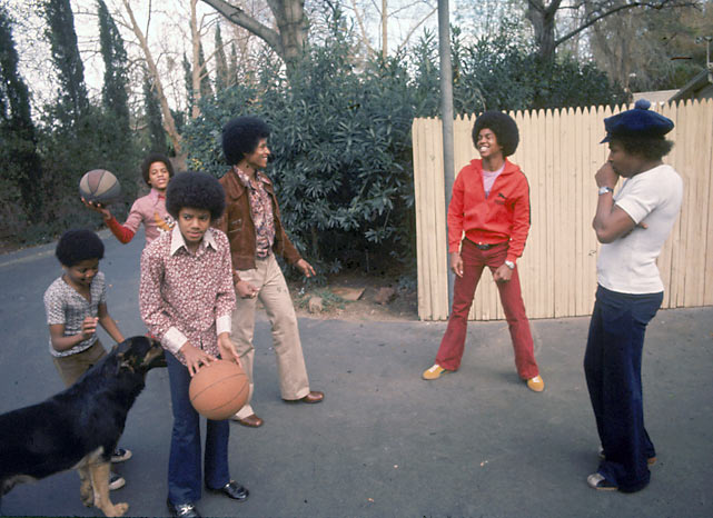 The Jackson Five take a break from the studio to play shoot hoops in the family's Los Angeles backyard. The photo, taken in 1972, features (from left to right) Randy, Marlon, Michael (holding ball), Jackie, Jermaine and Tito Jackson.