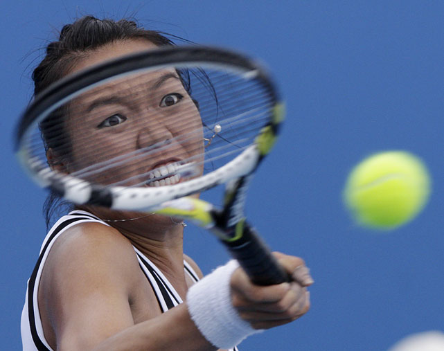 Vania King of the United States returns to Austria's Tamira Paszek during their first-round match. King lost the first-set tiebreak but rallied for a 6-7(4), 6-0, 6-3 victory.