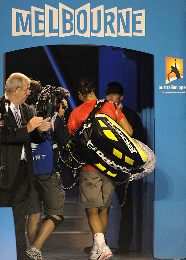 Nadal leaves the court after losing against Ferrer.
