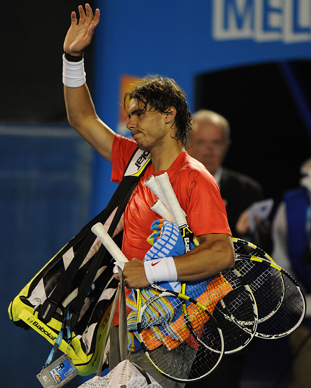 Nadal leaves the court after Wednesday's defeat.