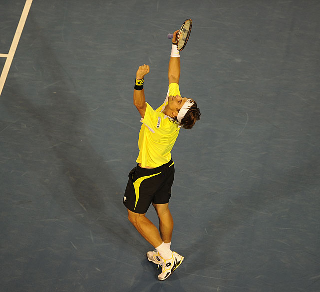 Ferrer celebrates his unlikely victory over Nadal.
