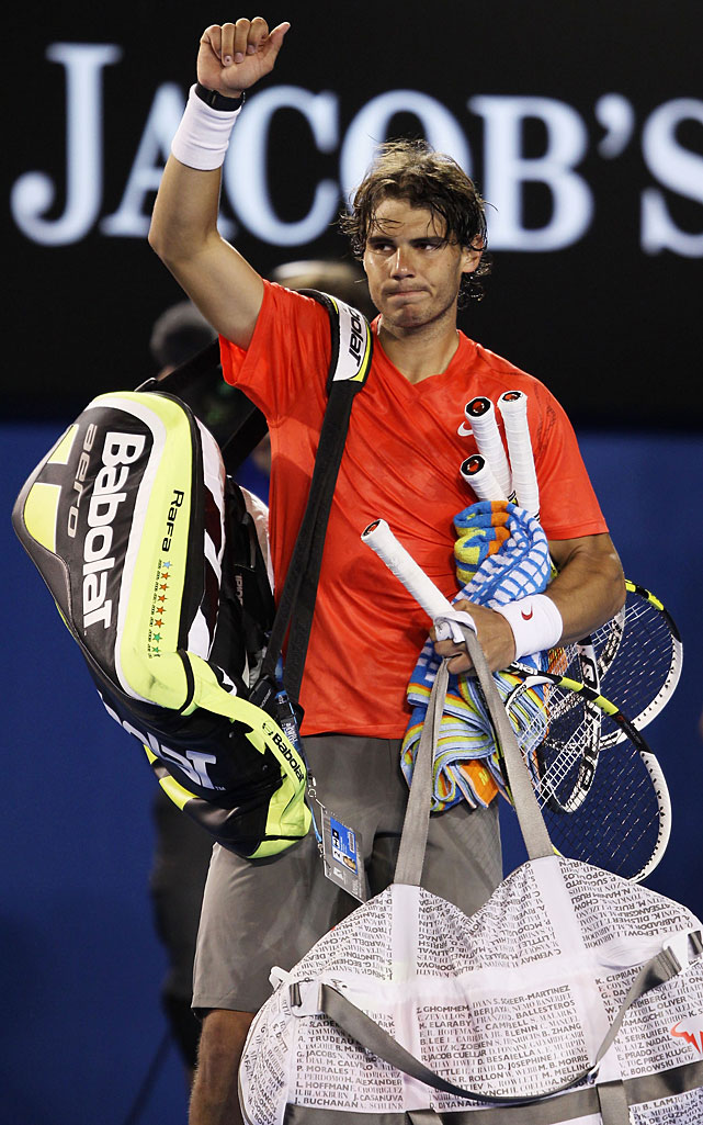 Nadal waves to the crowd after his 6-4, 6-2, 6-3 quarterfinal loss to Ferrer.