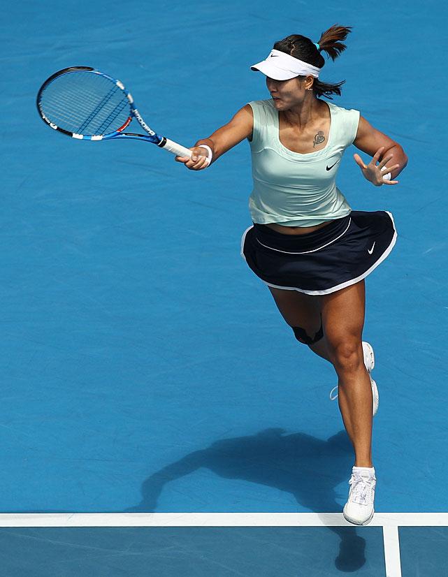 Li Na plays a forehand return to Wozniacki.