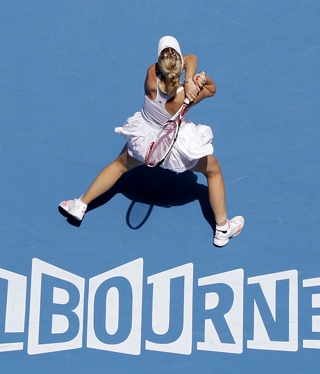 Caroline Wozniacki of Denmark returns to Li Na of China during Thursday's first women's semifinal in Melbourne.
