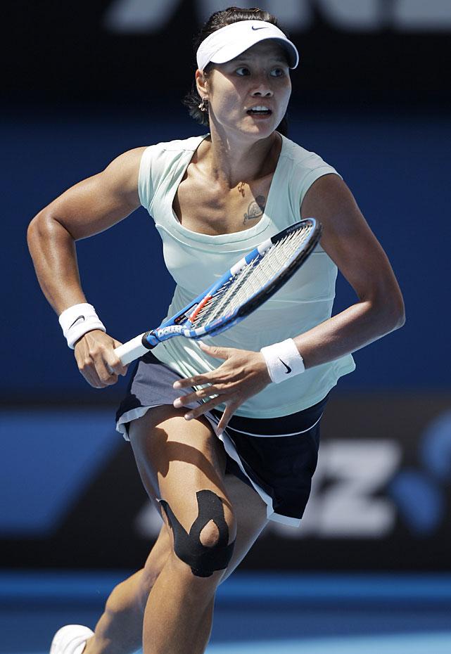 Li runs to return a shot to Wozniacki.