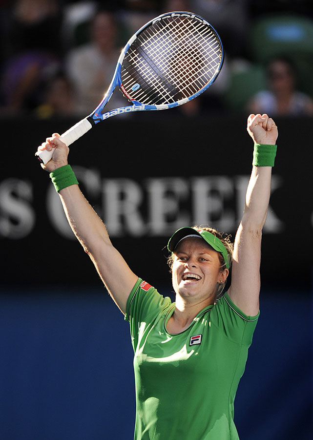 Clijsters raises her arms to celebrate her 6-3, 6-3 victory over Zvonareva.