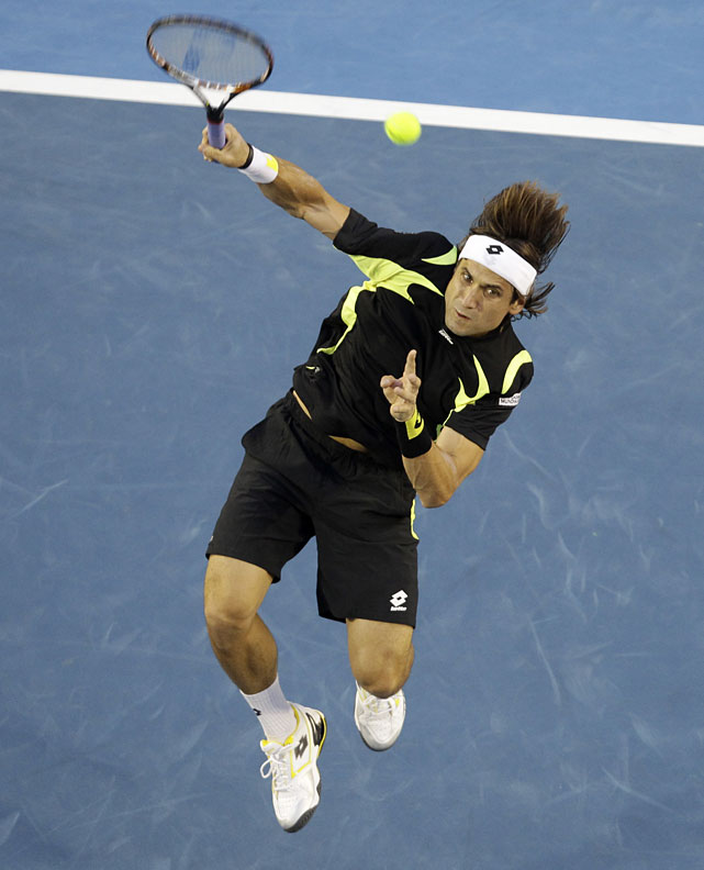Ferrer makes an overhand return to Murray during Friday's match.