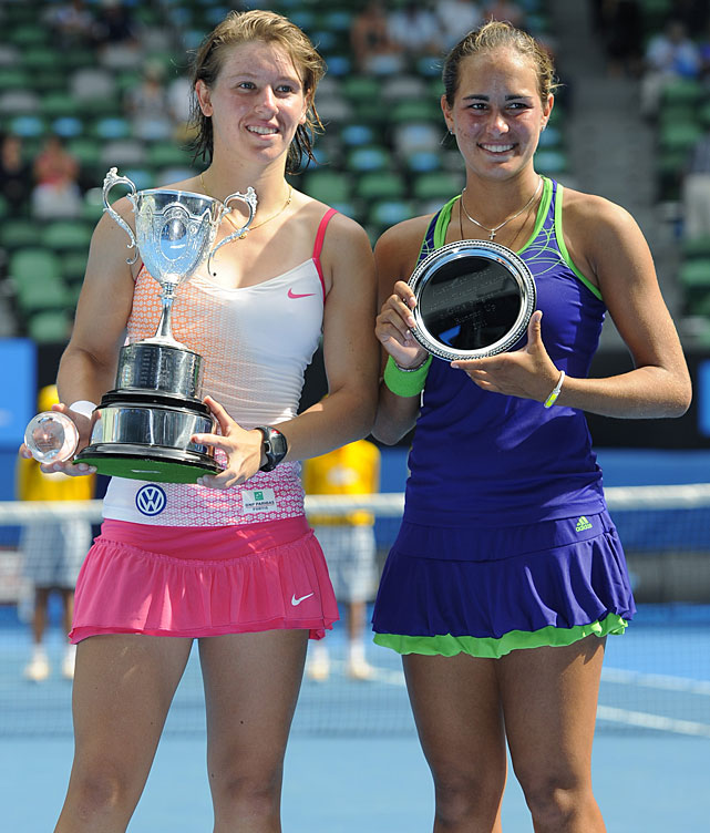 Mestach (left) holds her trophy after defeating Puil (right) in the girls' singles final.