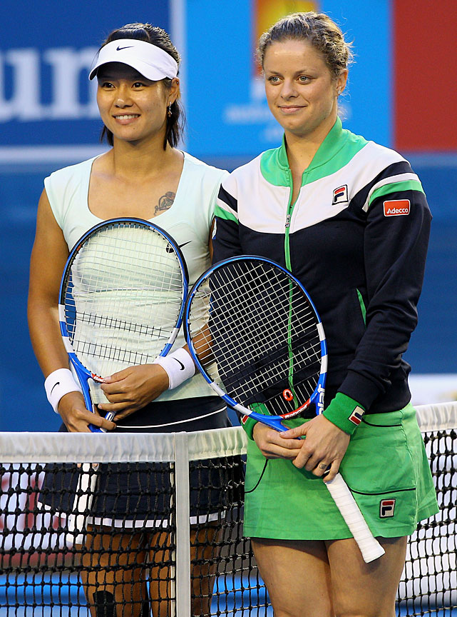Li and Clijsters pose at the net before their match.