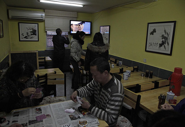 Li is seen on television during the Australian Open women's final as patrons at a Beijing restaurant watch.