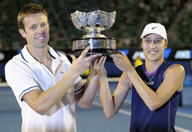 Slovenia's Katarina Srebotnik (right) and Canada's Daniel Nestor hold their trophy aloft after defeating Chan Yung-Jan of Taiwan and Australia's Paul Hanley in the mixed doubles final.