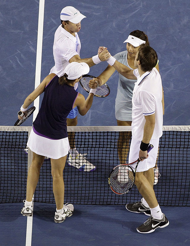 Srebotnik (bottom left) and Nestor (bottom right) shake hands with Chan (top right) and Hanley (top left) at the net after winning their mixed doubles final.
