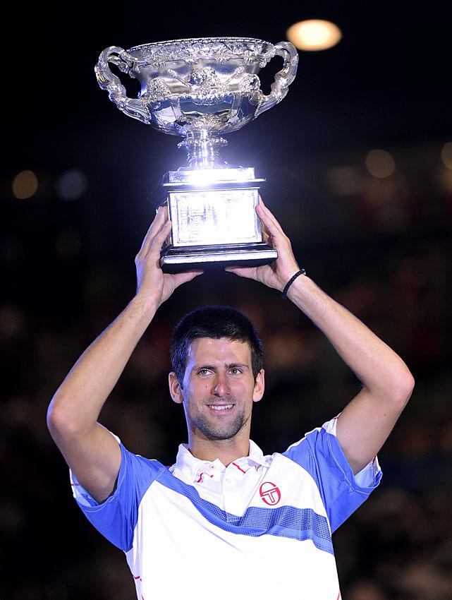 Djokovic raises the trophy.