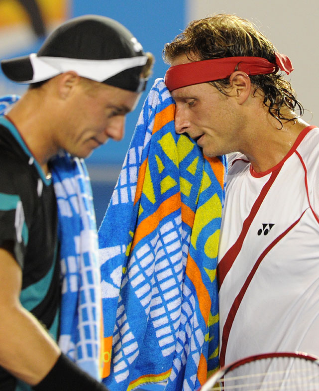 Hewitt and Nalbandian change ends during their first-round match at Rod Laver Arena.