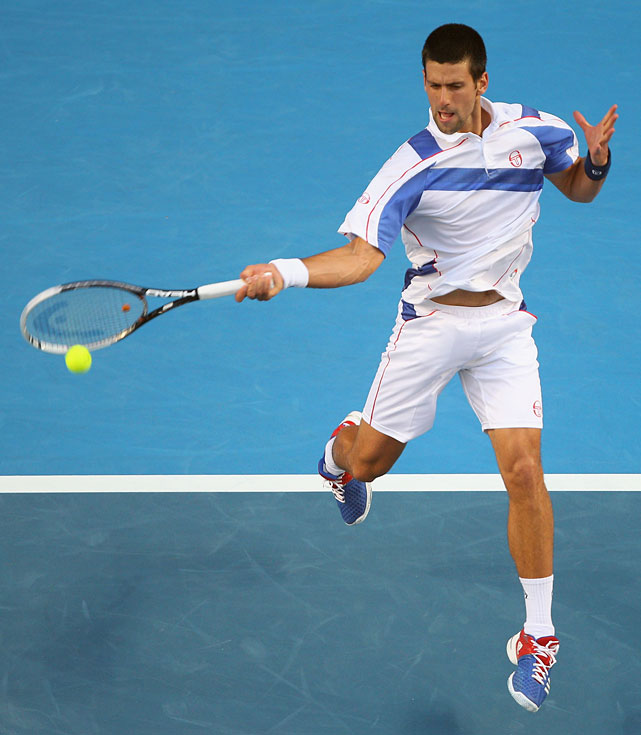 Novak Djokovic of Serbia plays a forehand during his second-round match against Ivan Dodig of Croatia. Djokovic won 7-5, 6-7(8), 6-0, 6-2.