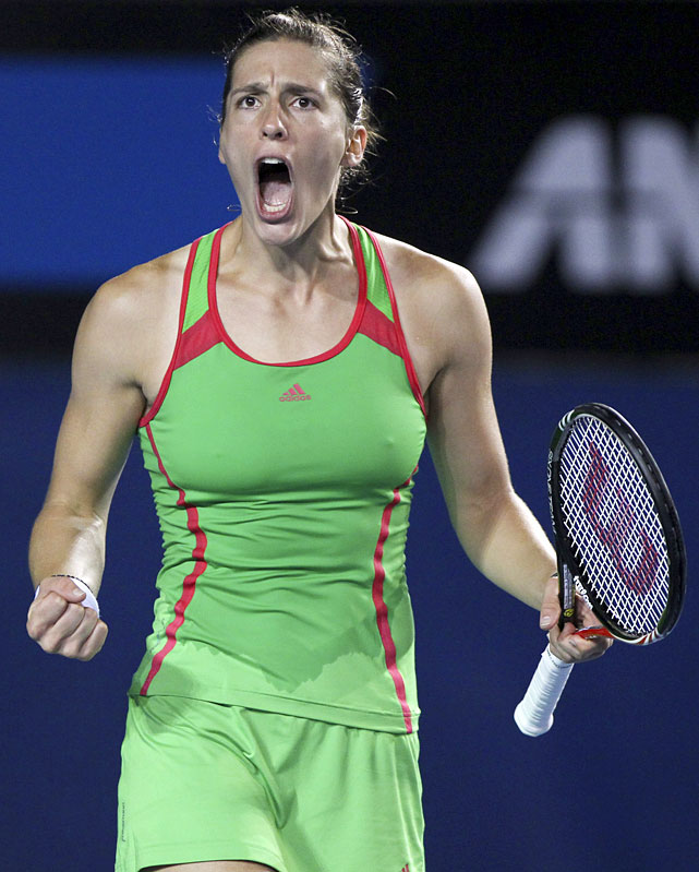 Germany's Andrea Petkovic yells during her second-round match against Great Britain's Anne Keothavong. Petkovic rallied for a 2-6, 7-5, 6-0 victory.