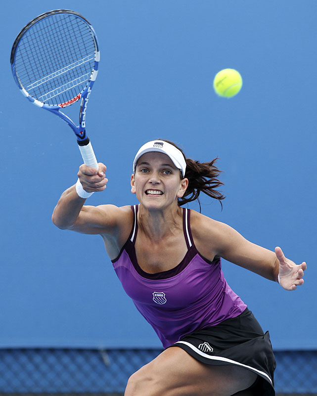 South Africa's Chanelle Scheepers makes a forehand return to Russia's Regina Kulikovaduring their second-round match.