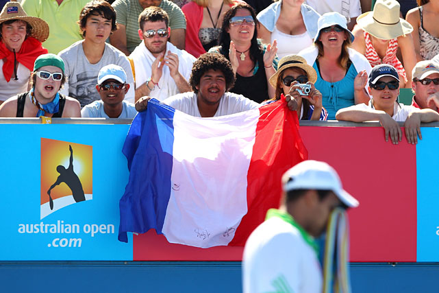 French fans show their support for Jo-Wilfried Tsonga during his second-round match against Andreas Seppi of Italy.