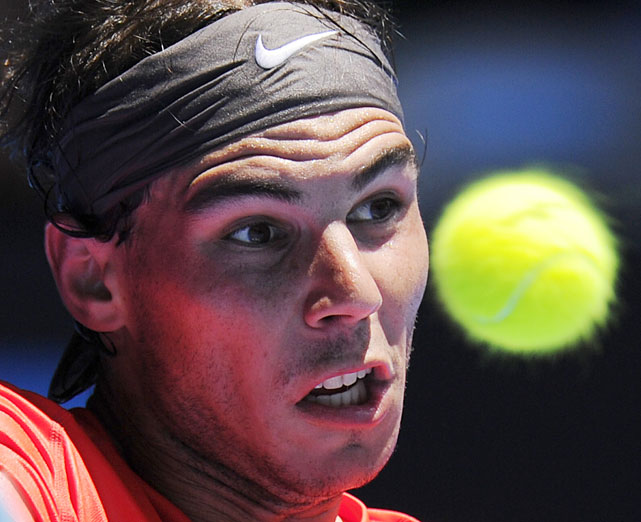 Spain's Rafael Nadal keeps his eyes on the ball as he makes a backhand return to Ryan Sweeting of the U.S. during their second-round match Thursday afternoon. Nadal won 6-2, 6-1, 6-1.