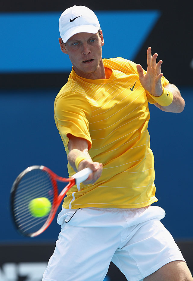 Tomas Berdych of the Czech Republic plays a forehand in his third-round match against Richard Gasquet of France. Berdych won 6-2, 7-6(3), 6-2.