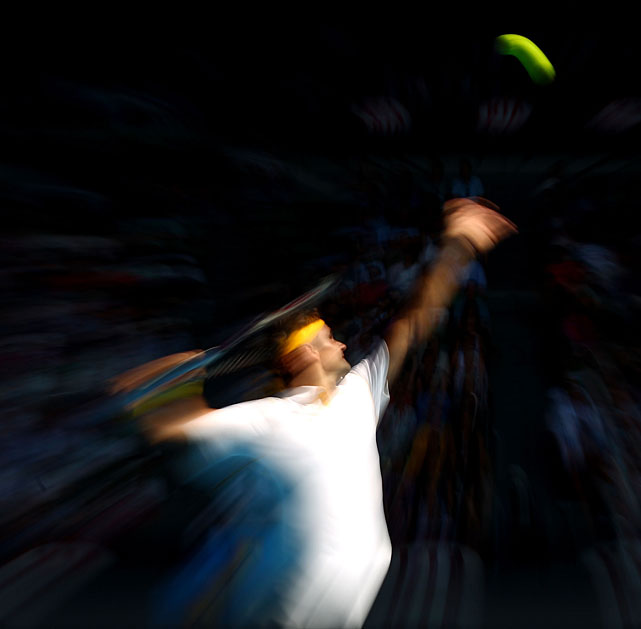 Roger Federer serves to Belgium's Xavier Malisse during their third-round match. Federer won 6-3, 6-3, 6-1.