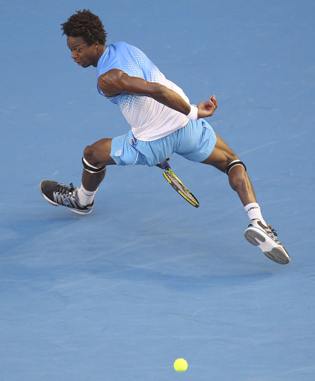 France's Gael Monfils plays a shot back between his legs during his third-round match against Switzerland's Stanislas Wawrinka on Friday night. Wawrinka won 7-6(4), 6-2, 6-3.