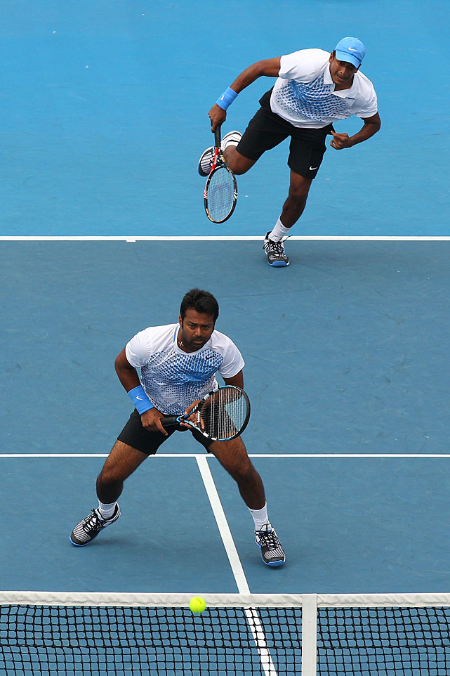 Mahesh Bhupathi of India (top) serves in his second-round doubles match with partner Leander Paes.
